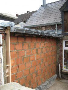 Rénovation extérieure d'un mur par ETS SGP, entreprise de bâtiment