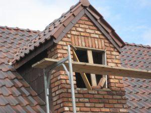 Rénovation de toiture en tuiles par l'entreprise de bâtiment SGP